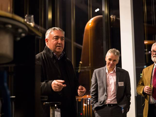Distillery Manager conducting evening tour in the Still House at The Clydeside Distillery