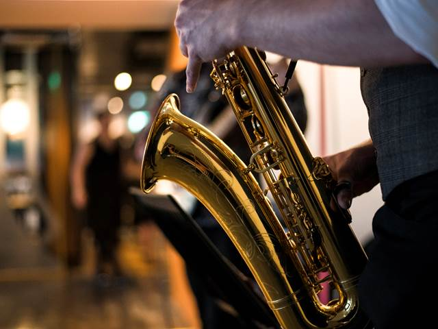 Focused-shot of saxophone from a string quartet band welcoming guests to The Clydeside Distillery