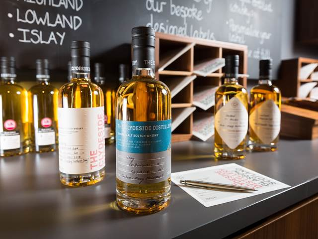 Four labelled bottles from the Label Your Own range available at The Clydeside Distillery