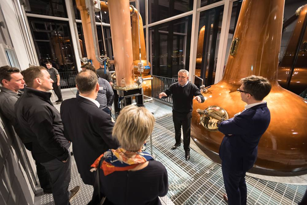 Alistair McDonald hosting group of guests during an evening tour at The Clydeside Distillery