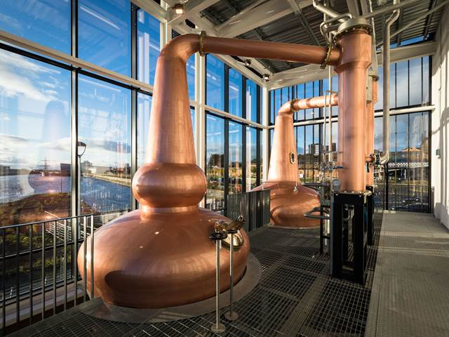 The Clydeside Distillery's glass encased Still House with two copper stills