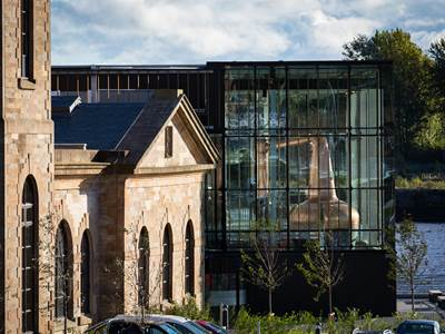External image of The Clydeside Distillery - includes contrast of old building and glass Still House