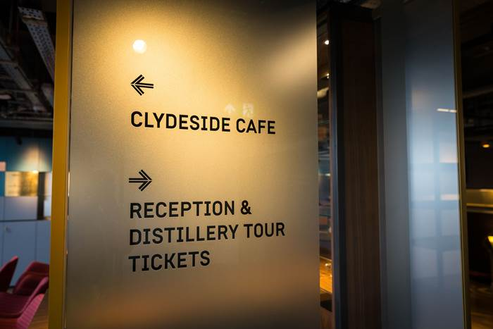 Directional signage to sign post Clydeside Café and Reception