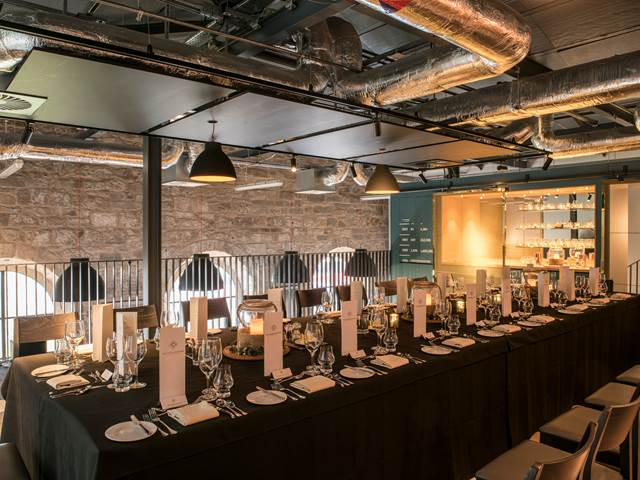 One dining set up for 20 places in the Tasting Room at The Clydeside Distillery