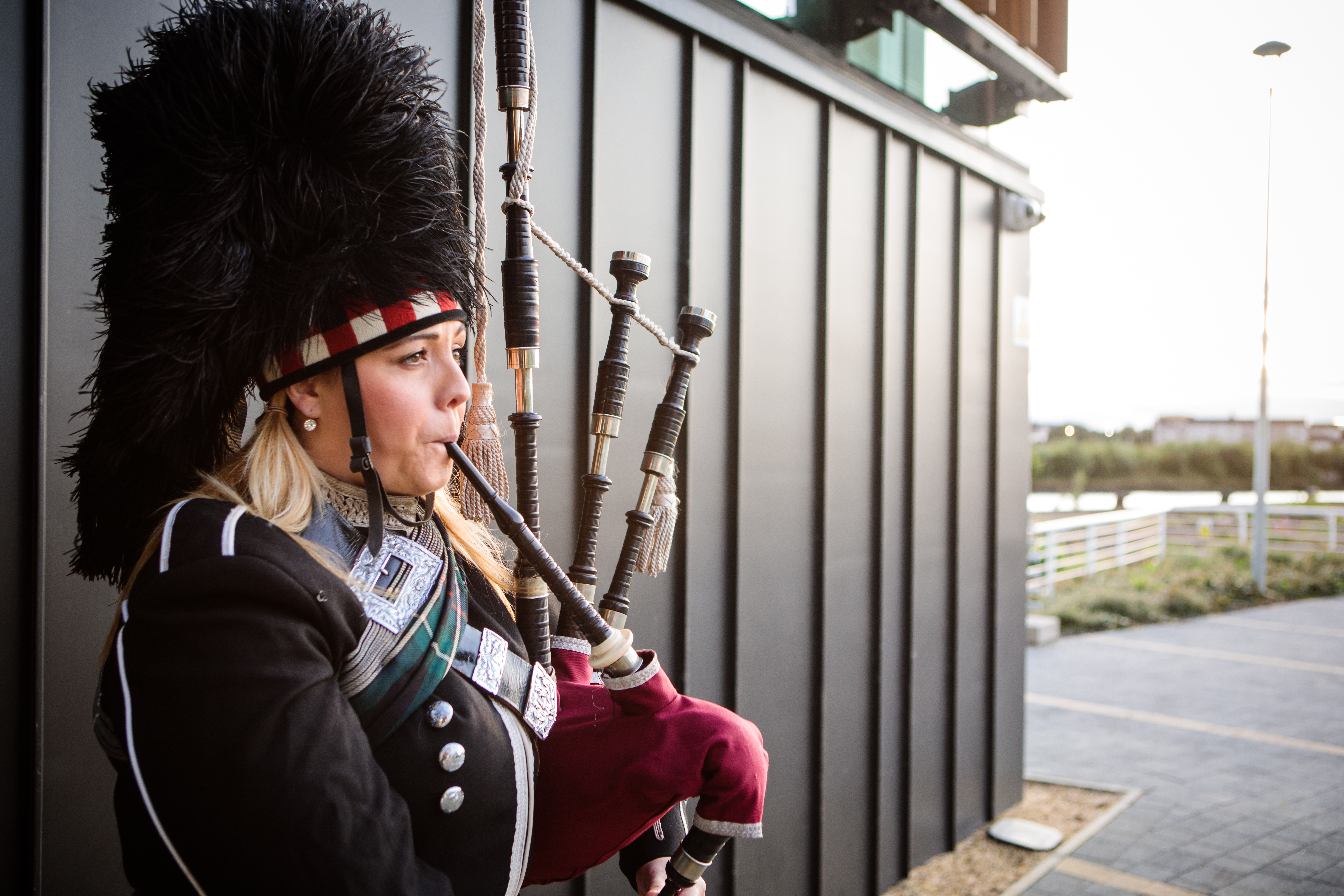 Scottish Piper Welcome Outside The Clydeside Distillery