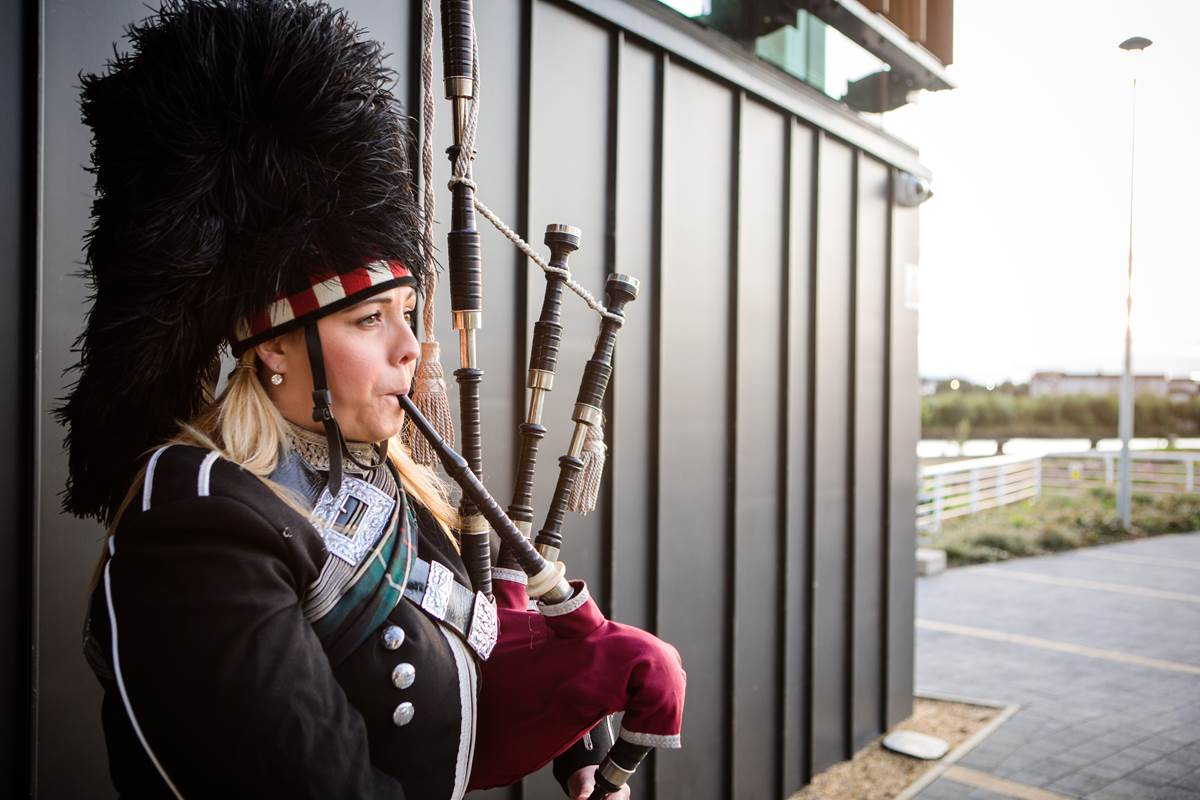 Scottish piper outside main entrance at The Clydeside Distillery